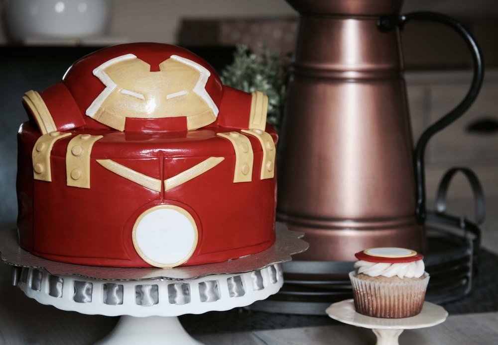 Original Hulk Buster Design Birthday Cake made of fondant with matching buttercream cupcakes.