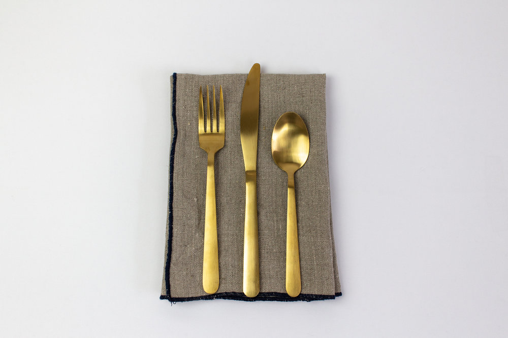 Sword in the Stone Napkin with Gold Stemware.jpg