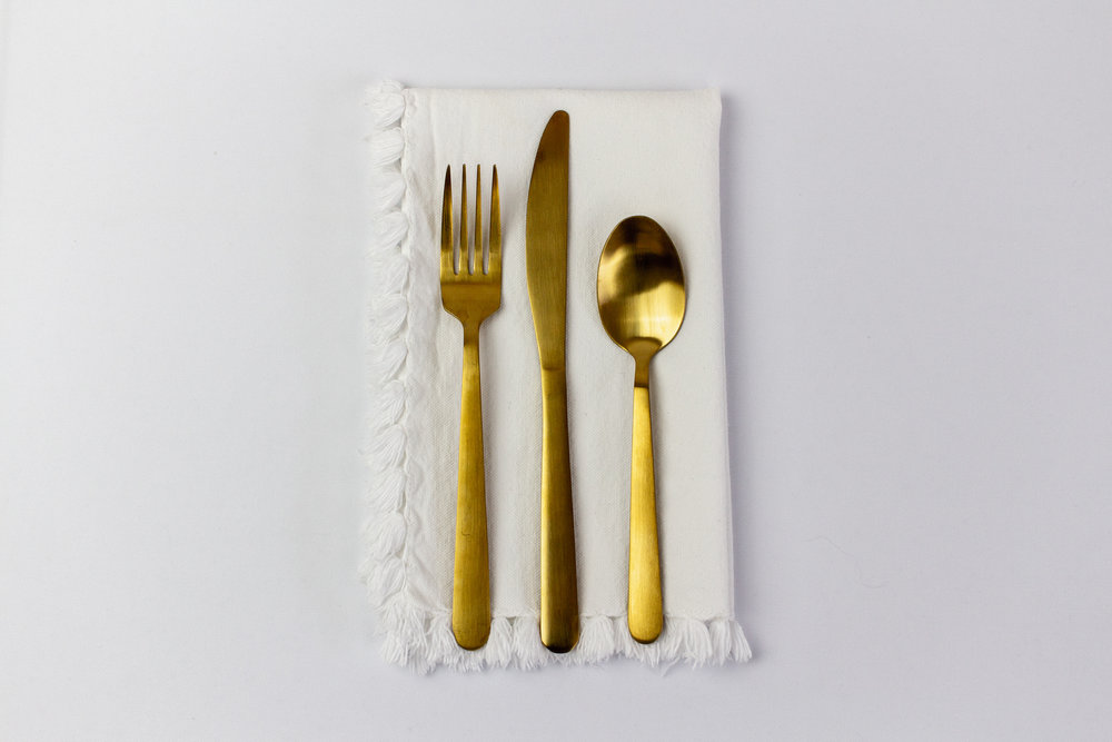 White Tassel Napkin with Gold Stemware.jpg