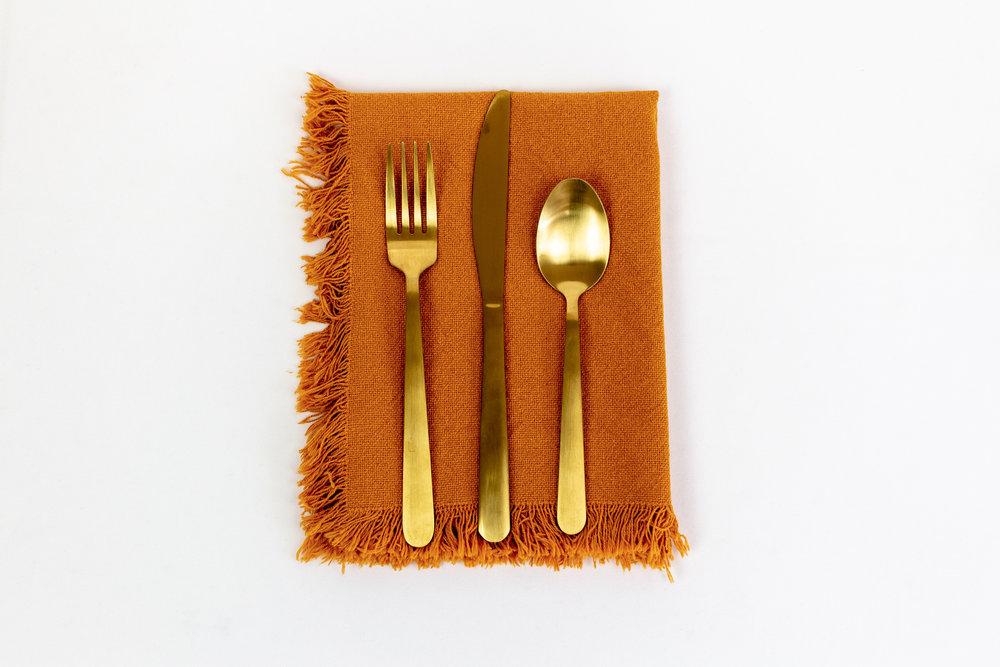 Amber Fringe Napkin with Gold Stemware.jpg