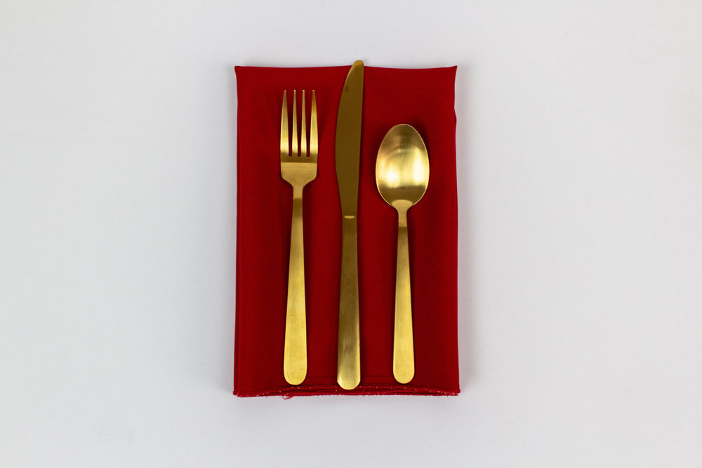 Santa's Ass Napkin with Gold Stemware.jpg