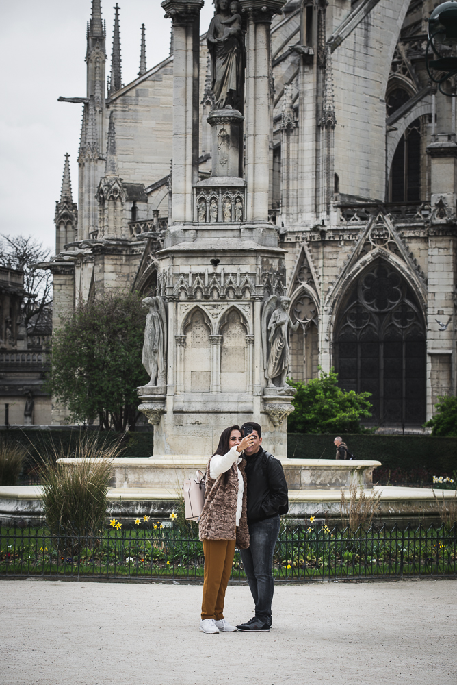 couple taking a selfie in paris in front of a church-1.jpg