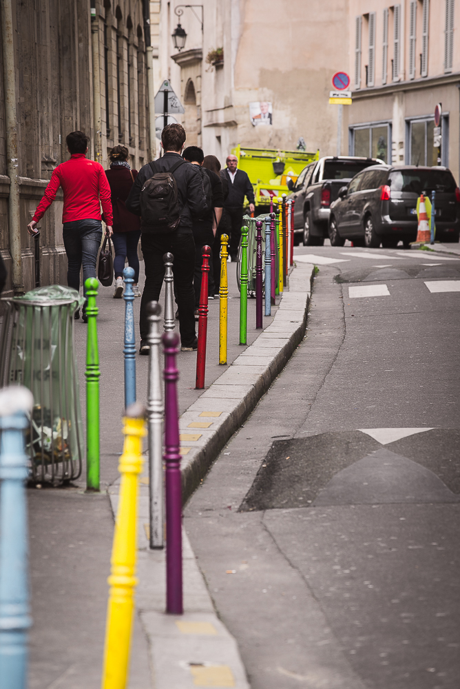 colourful sticks in street in paris and people walking-1.jpg
