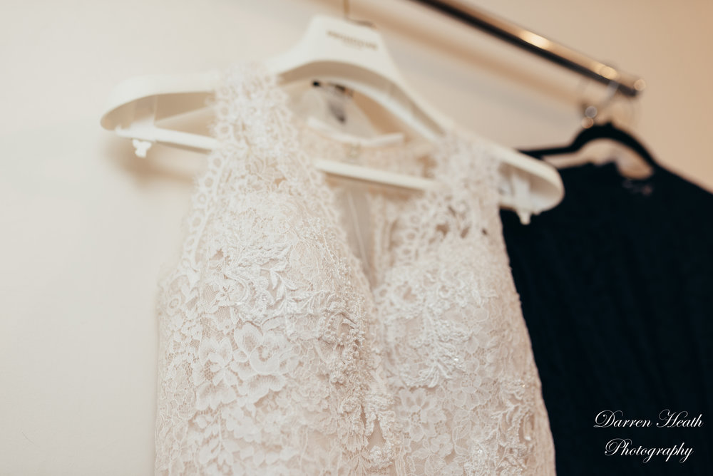 Wedding Dress and Bridesmaid Dress hanging up