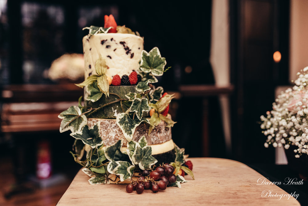 A 3 tiered actual cheese wedding cake