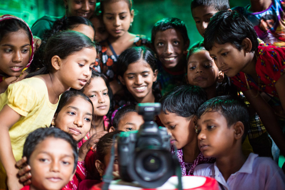 Children at a BRAC school in Dhaka watch a video of themselves