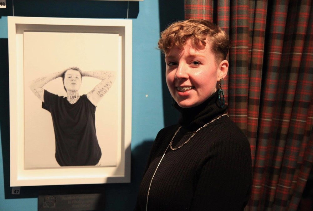 Eliza and her portrait at the SPA exhibition in Edinburgh, November 2018
