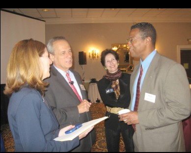 Duby McDowell, from left, greets her former teacher, Red Sox CEO Larry Lucchino, with MetroHartford Alliance vice president Nancy Wheeler and attorney George Springer.