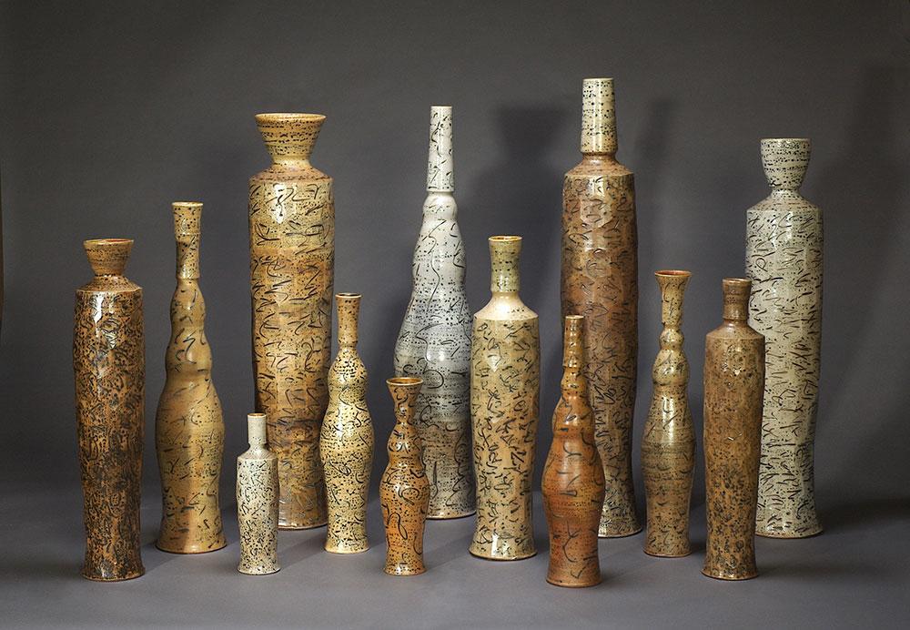 """1. Bottle Group , wood-fired, salt-glazed stoneware, tallest 51""""h (2008)"""