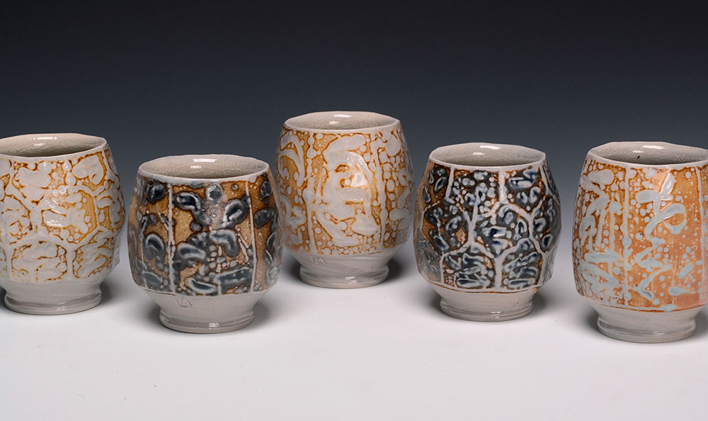 """3. Five Faceted Cups with Markings , wood-fired, salt-glazed porcelain, 3.5""""h each (2017)"""