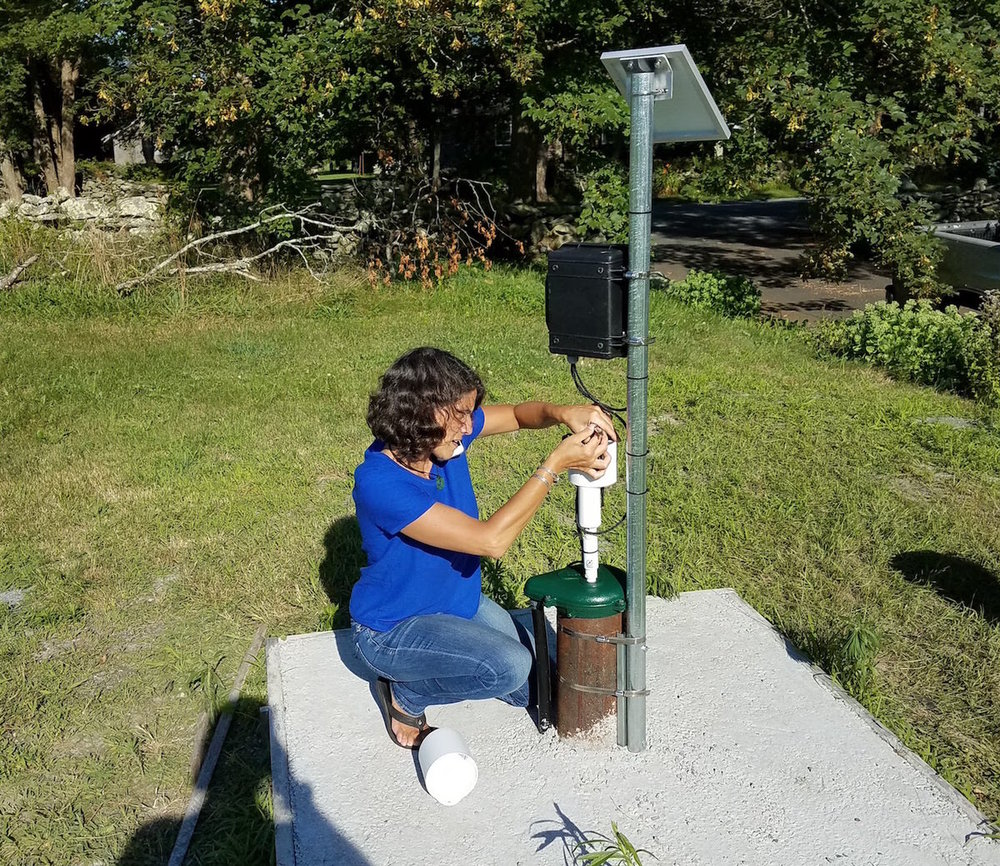 ImpactLABS deploying groundwater sensor.jpg