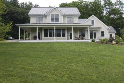 Modern Greek Revival farmhouse addition in Newfane Vermont- older addition by others is to the right