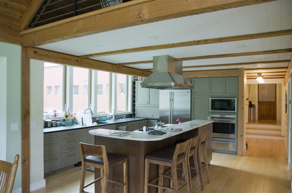 This was a renovation. I added a bump out bay for the kitchen and brought the ceiling plane in the bay above the existing ceiling level. the effect over the sink was similar to a skylight.