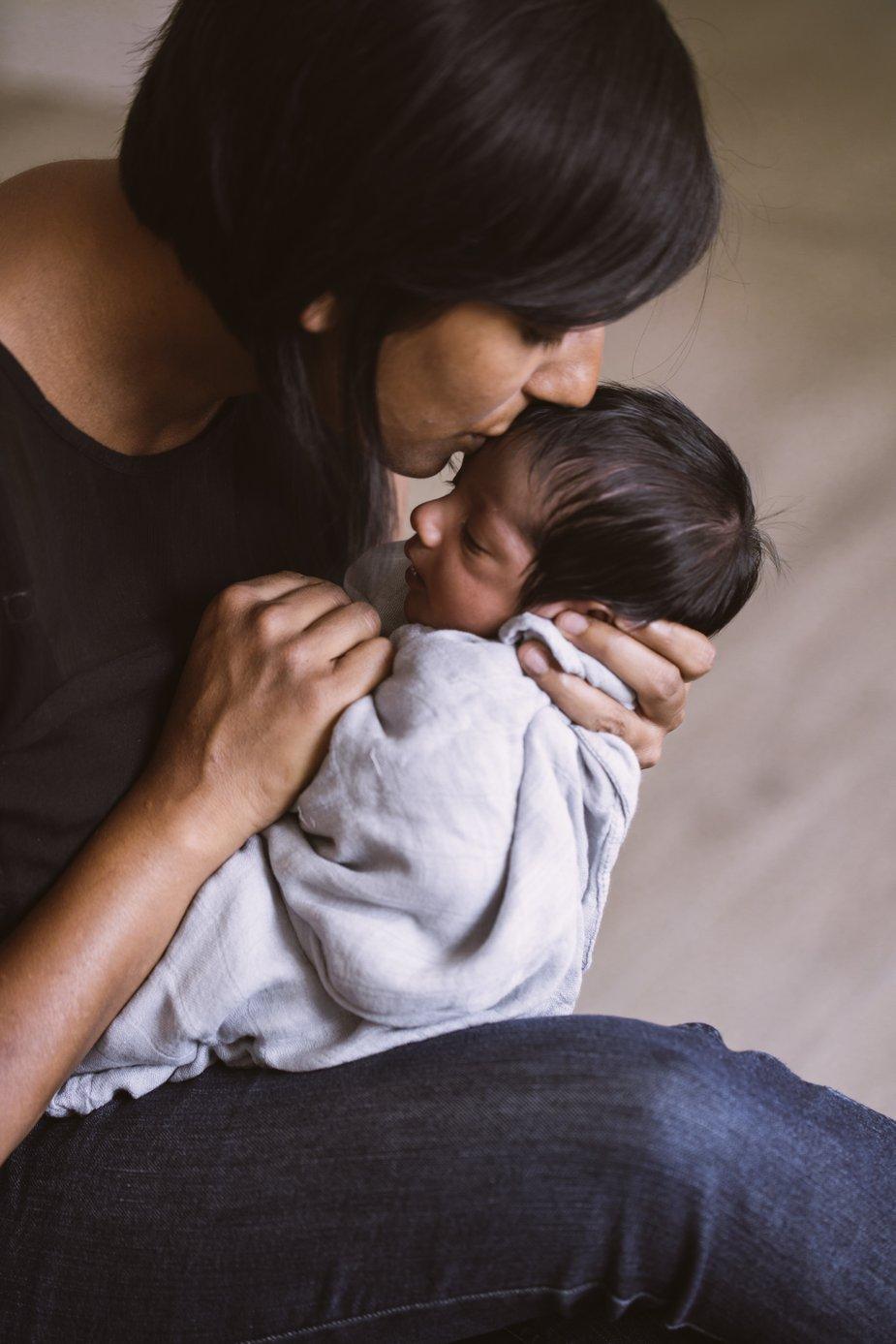 mother-kissing-newborn_925x.jpg