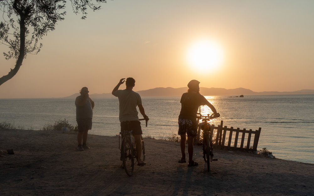 Sunset at Pissa Beach. We don't know the man on the far left.