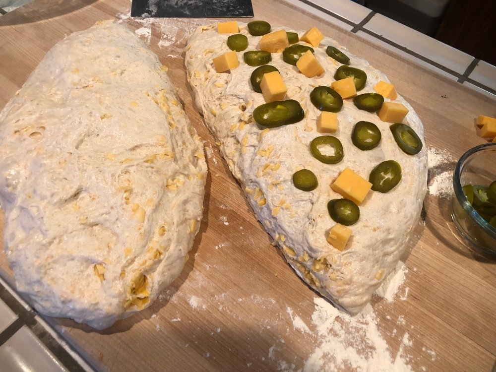 Start layering Jalapenos and cheddar cubes into the dough before you shape it for the 30 minute bench rest.