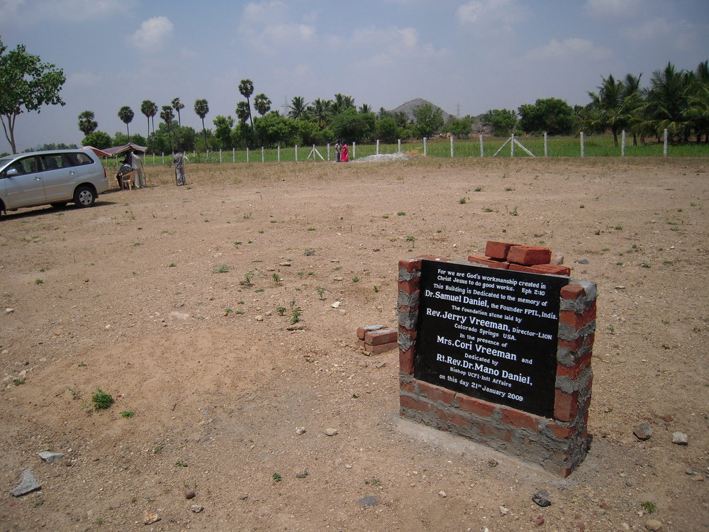 Dedication stone on the land