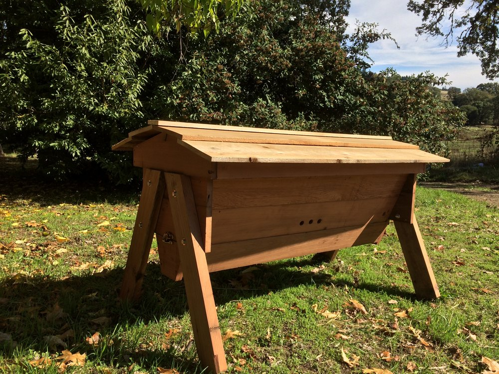 Top Bar Beehives - When we're not busy in the garden, we're busy building!  Beehives bridge the gap between garden and natural building.  We build Kenyan Style Top Bar Beehives, from renewable and non-toxic materials.Top Bar Hives aren't designed for production of honey, but rather to provide natural habitat for honeybees.  They allow honeybees to build their own comb to their own requirements, are easy to manage, and are perfect for beginners or experienced beekeepers!  Honeybees also provide the very important benefit of increasing pollination in our garden.  A shared relationship and harmony can be achieved with Honeybees, if only we look to their needs before our own. All sales and proceeds from our Top Bar Hives will go directly towards increasing awareness of natural beekeeping in Canada, and supports The Kootenay Society For Sustainable Living.