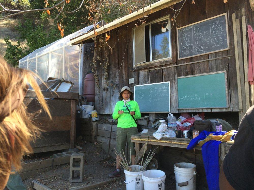 Marisol teaching in the garden.