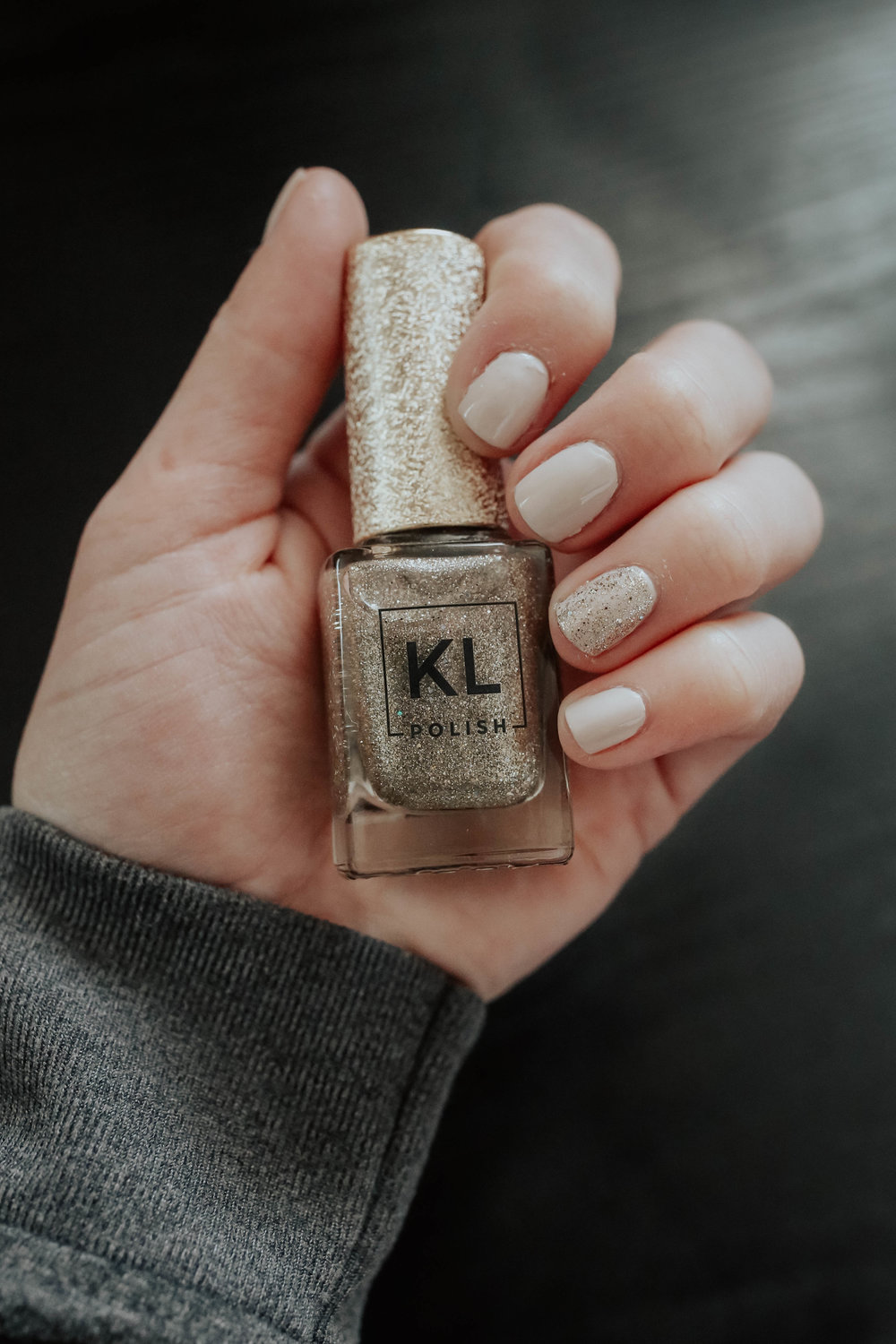 """3. KL nail polish - this is great for any beauty lover, and i've given them to friends' kids as well. all of the polishes are 12-free, meaning there are less toxic chemicals than some of the polishes sold in drugstores. the formula is super long-lasting and comes in so many colors that just about anyone will find a color they like. i'm pictured wearing """"Pinky"""" and """"Das Esspensive."""""""