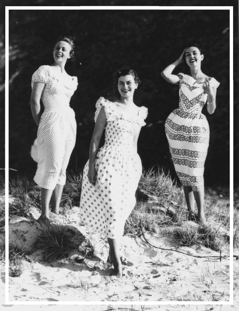 StateLibQld_1_198347_Models_wearing_billowy_dresses_on_the_beach_at_Surfers_Paradise,_1951.jpg