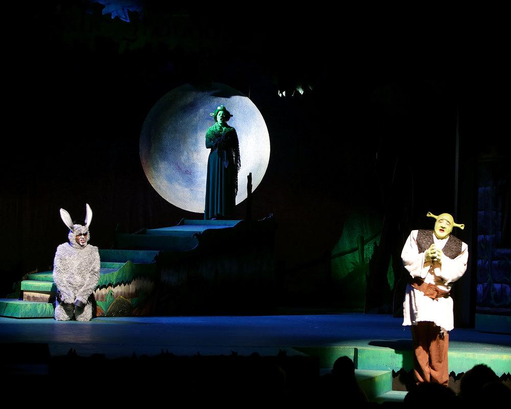 Featuring Ken-Matt Martin as Donkey (left), Jill Ziegler as Princess Fiona (middle), and Lance Noe as Shrek (right).