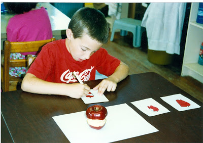 This student is drawing the various stages of an apple as he eats it as seen in the lesson  Look, Eat, and Draw .