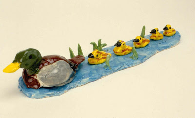 The mallard duck with her ducklings above was done by a twelve-year-old student who loves the out of doors.