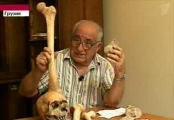 Dr.Vekua holds up giant bones found in Borjormi-Kharagauli National Park in the Georgian Caucasus