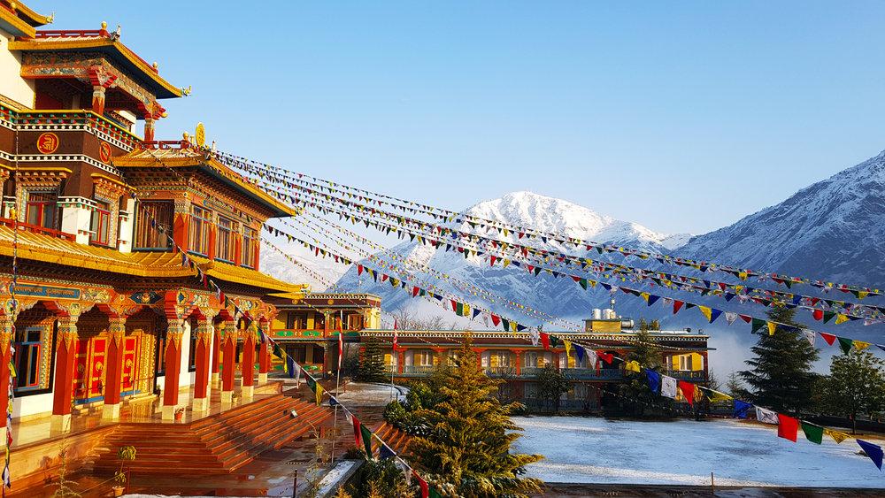 Dechen Choekhor and the snow-capped Chakrasamvara Holy Mountain