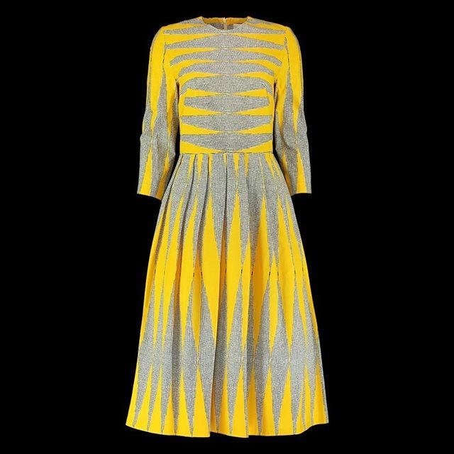 One of @eponinelondon colorful dresses shot on mannequin.