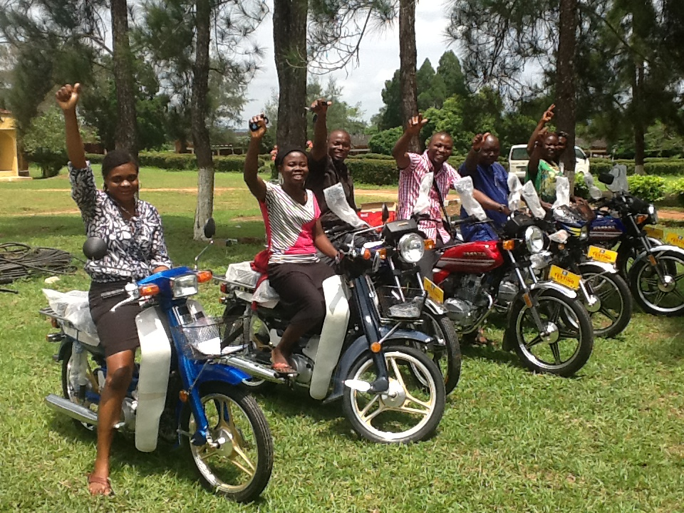 P C staff cheer up after receiving new bikes for field  work.JPG