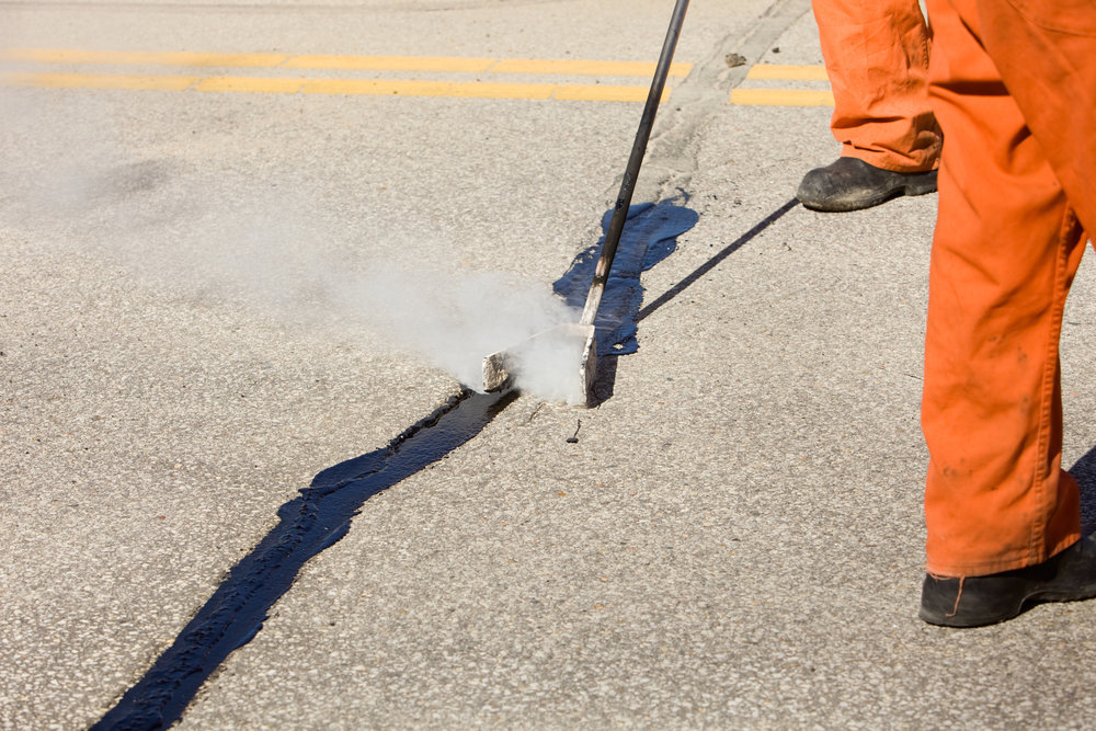 Asphalt Crack Sealing - We offer Crack Routing as well as Hot Crack Sealing.