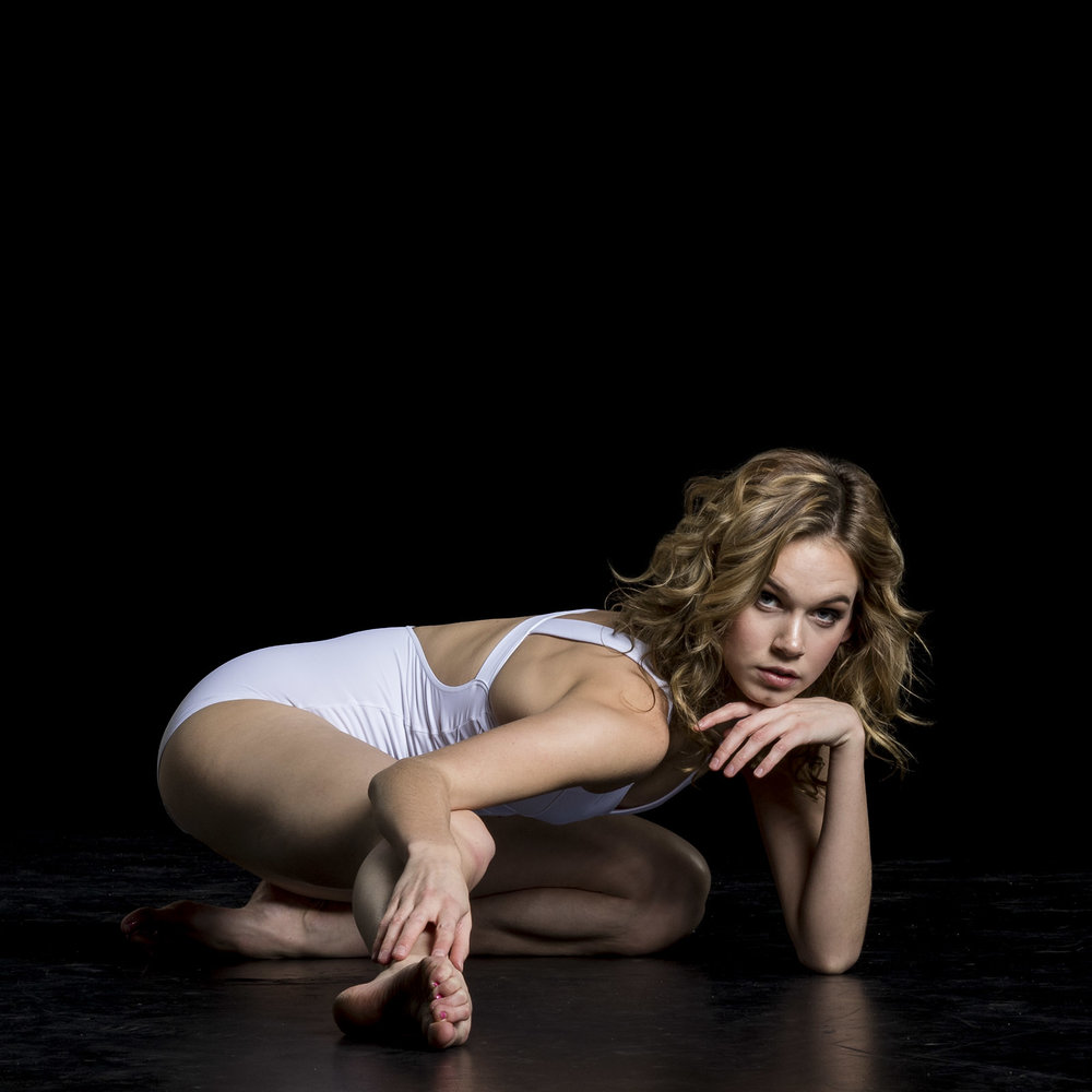 female-dancer-posing-on-floor.jpg