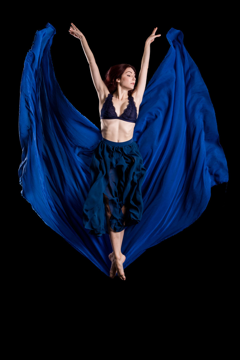 female-dancer-jumping-with-blue-fabric.jpg