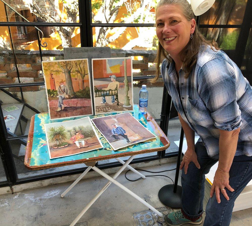 Kim with paintings.JPG