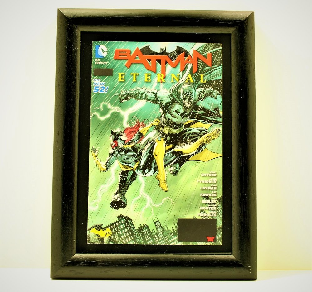 framed batman comic book art