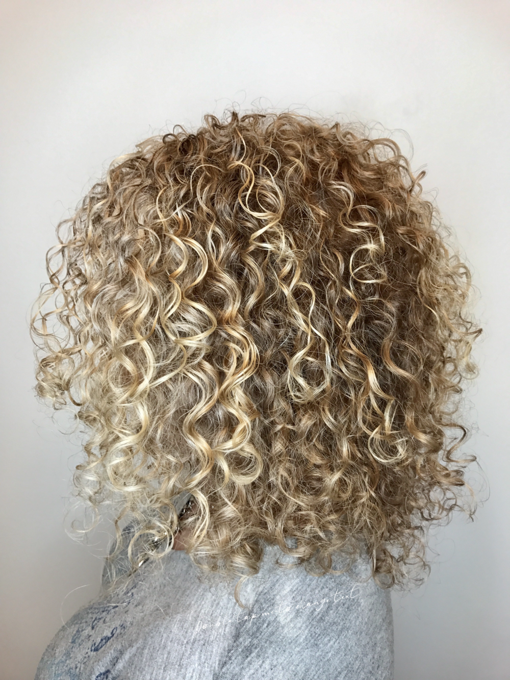 blonde-curly-layered-hair-cut.PNG