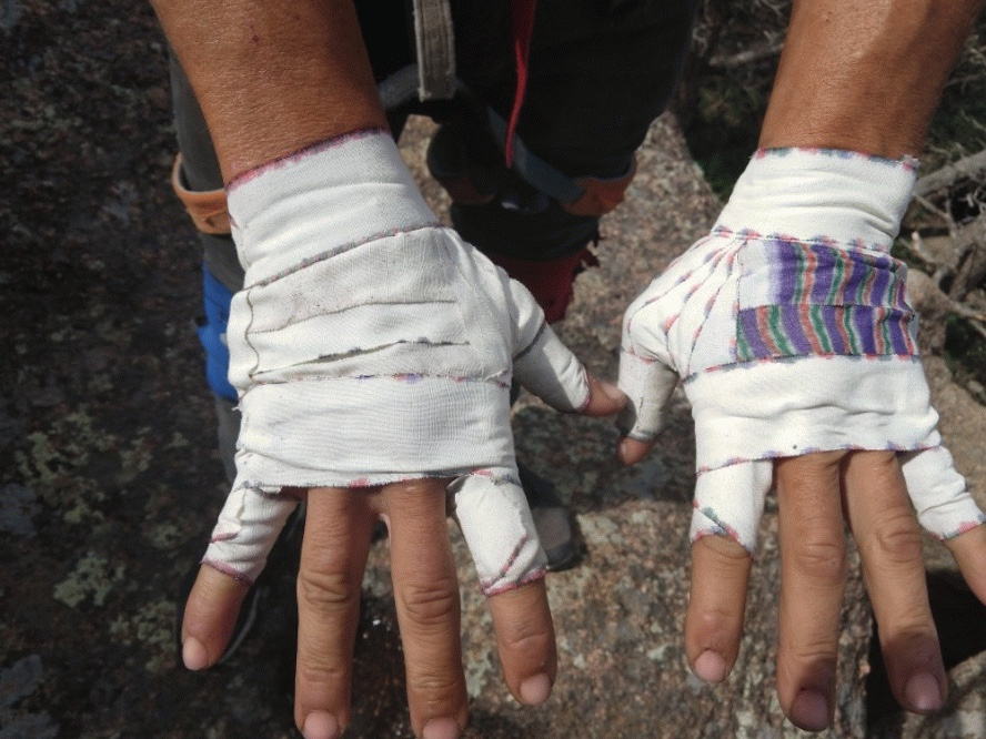 The fully prepared hands of a professional athlete, Devin Fin in Vedauwoo, WY.