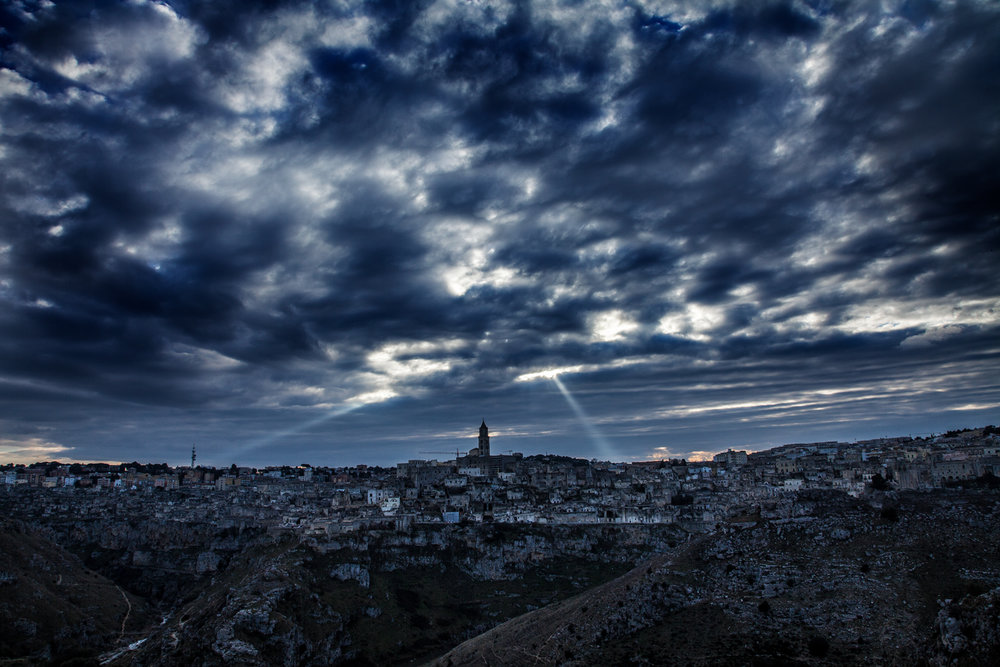 Matera across the  Torrente Gravina di Matera valley, sunset .jpg