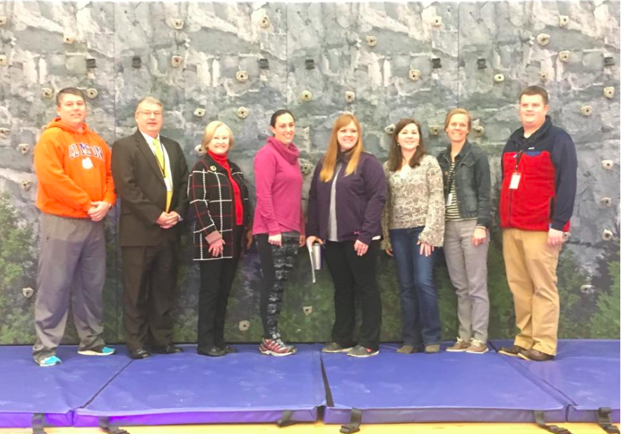 Funds raised from our Fall Fling were used to purchase our Rock Climbing Wall. Pictured (Coach Wellborn, Bill Miller (grandfather and past Superintendent, Mayor of Banner Elk Brenda Lyerly, PTO members: Jill McPhail, Kerri Ledford, Madison Tapio and Joy Pritz, Principal-Justin Carver