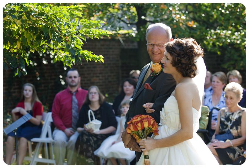 bride giving away daughter garden wedding