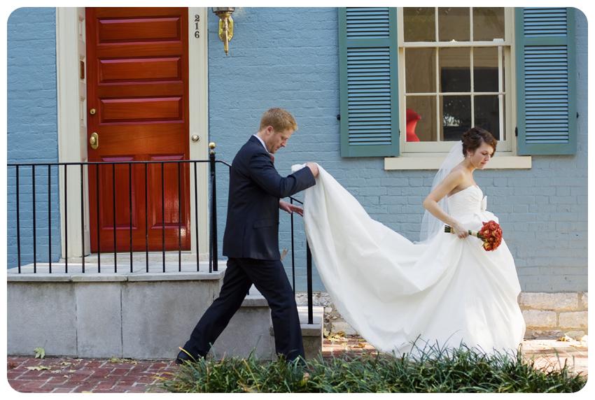 groom carrying bride's train in lexington, kentucky