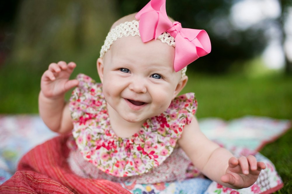 22-floral-baby-girl-laughing-portrait.jpg