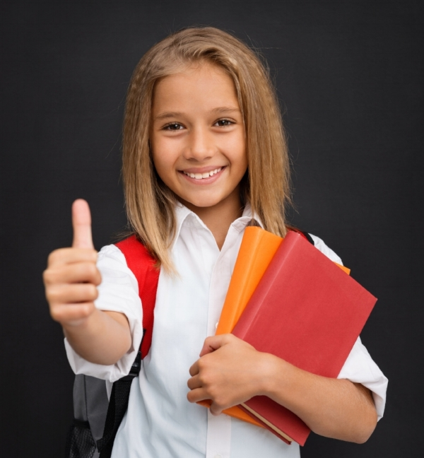 5th grade girl thumbs up iStock-505484359_Pixelfit.jpg