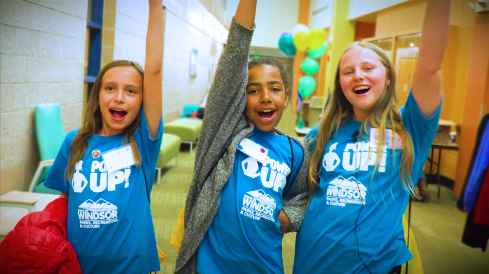 Diverse group of 5th grade girls having fun in school