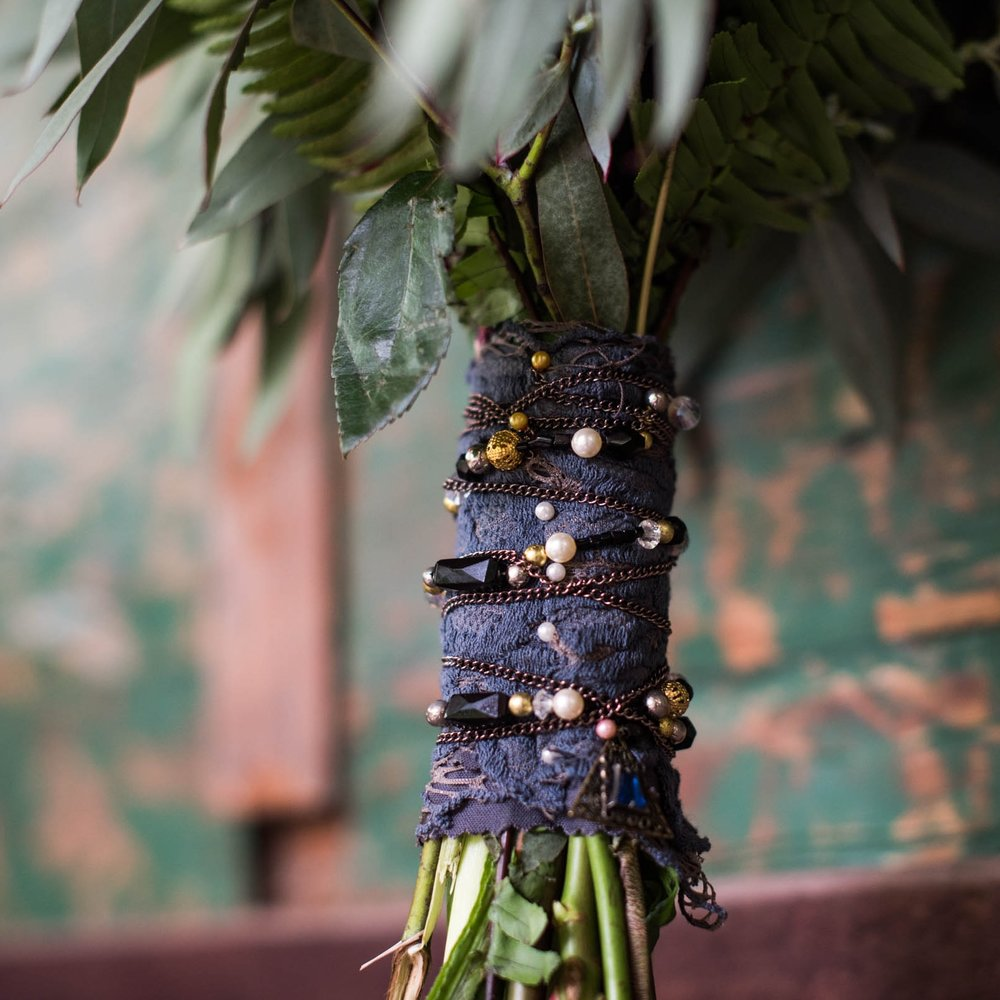 """Perfection Is in the Details - We consider every detail when crafting your floral arrangements. Embellishments of beads, ornaments, shells, natural woods, lace, ribbon and other finishing touches create arrangements that look stunning from every angle. The elegant interplay of """"natural"""" and """"traditional"""" are what make each and every Simply Rustic floral piece special."""