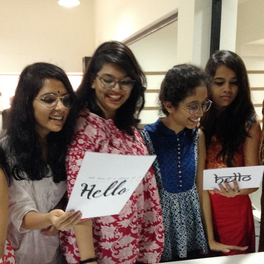Students in Mumbai creating typographic personality analyses