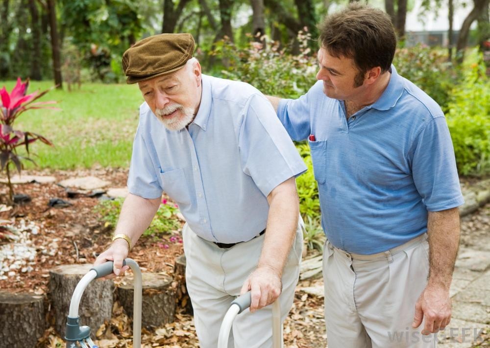 man-in-blue-shirt-with-old-man-and-walker.jpg