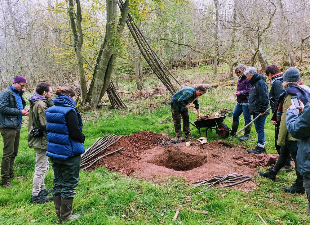 Building a ground oven as part of a day's workshop for food educators.